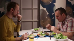 Men have dinner at the table, drinking and talking Stock Footage