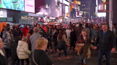 People crossing street in Times Square at night time lapse 4k Stock Footage