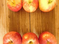 apples on wooden base - stock photo