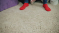 Christmas socks, my mother teaches her child to walk - stock footage