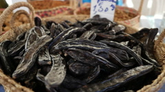Carob tree at the market in Portugal Stock Footage
