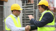 Reaching an agreement on construction site Stock Footage