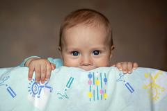 The baby in her crib - stock photo