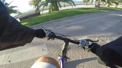 Cycling on a bike lane in first person view Stock Footage