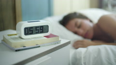 Young woman is sleeping in the morning when ring the alarm. Stock Footage