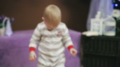 little boy holding a mandarin and dancing on Christmas - stock footage