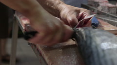 Chef cuts fish to pieces in a restaurant. Stock Footage
