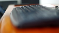 Keyboard in and out of focus followed by index finger pushing enter Stock Footage