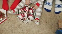 Young family at the celebration of the new year. Christmas clothes Stock Footage