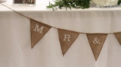 """Mr & Mrs"" Flag on Head Table at Wedding Stock Footage"