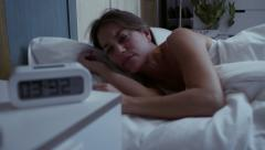 Young beatiful woman with insomnia can't sleep at night - stock footage