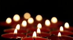 Red candles burning Stock Footage
