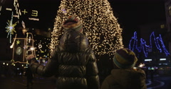 4K Cinemagraph: Kids With Sparkler In Front Of Christmas Tree Stock Footage