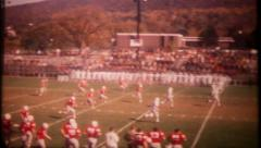 2909 - action at the local high school football game - vintage film home movie Stock Footage