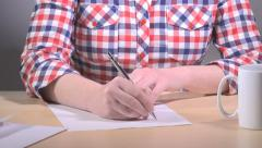 Woman writing letter at office desk - stock footage