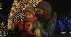 4K Cinemagraph: Mother Hands Christmas Present To Her Daughter - stock footage