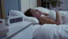 Young woman with insomnia can't sleep at night - stock footage
