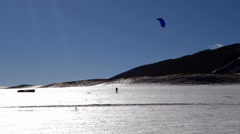 Snowkiting lessons in a snow-covered valley Stock Footage