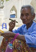 Stock Photo of Old Asiatic woman smoking