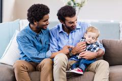 Happy gay couple with child Kuvituskuvat
