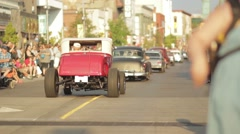 Classic Cars Parade Down Main City Street at Car Show Stock Footage