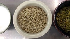 Sunflower-, pumpkin- and linseed seeds, in porslin bowls, at a restaurant kit Stock Footage