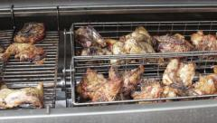Chickens Roast on an Outdoor Grill/Rotisserie Stock Footage