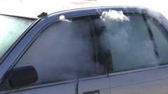 Smoke comes out of burning car Stock Footage