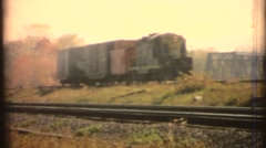 Vintage 8mm Diesel Railroad trains and caboose Stock Footage