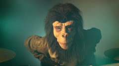 Man with monkey mask playing drums #2 Stock Footage