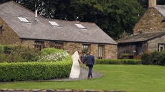 Bride & Groom Walking to Country Lodge at Wedding Stock Footage