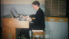 2915 - young man plays the church organ at wedding - vintage film home movie - stock footage