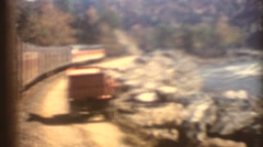 Vintage 8mm Diesel Railroad trains, Side as train makes curve Stock Footage
