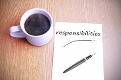 Coffee on the table with note writing responsibilities - stock photo