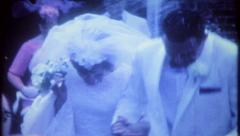 2918 - wedding guest throw rice at the newlyweds - vintage film home movie - stock footage