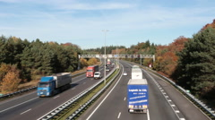 Highway A1 in the countryside from the Netherlands in fall Stock Footage