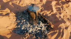 Making an italian coffee on sahara desert sand Stock Footage