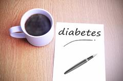 Coffee on the table with note writing writing diabetes Stock Photos