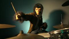 Man with monkey mask playing drums #1 Stock Footage