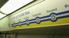 Metro map on subway car wall, names of stations in Greek language, transport Stock Footage