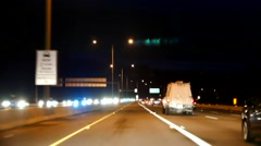Blur motion of driving car in highway at night with miniature effect Stock Footage
