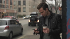 Male Texting and Takes Sip of Coffee while Waiting. - stock footage