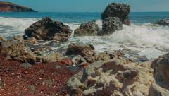Mediterranean Volcanic Beach with Red Sand and Surf Hitting the Rocks Stock Footage