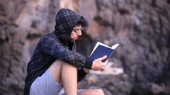 A guy reading a book Stock Footage