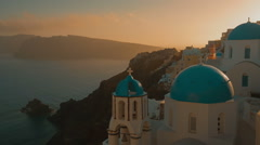 Traditional Blue Dome Cycladic Church and the Aegean Sea Stock Footage