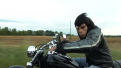 Man with monkey mask driving a motorcycle #1 Stock Footage