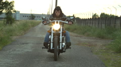 Man with monkey mask riding a motorcycle #1 Stock Footage