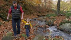 Father cleans hands her little son, then walking by the river, untouched nature. Stock Footage