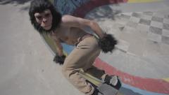 Man with monkey mask skateboarding #1 Stock Footage