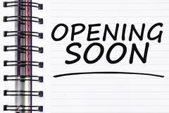 Opening soon words on spring white note book Stock Photos